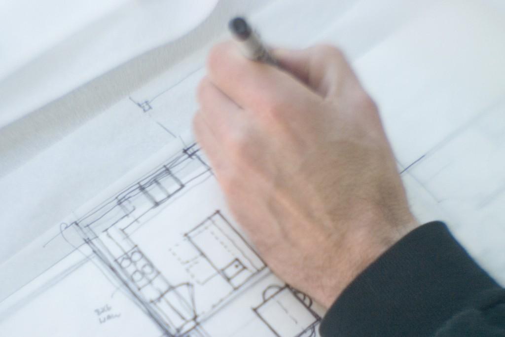 Close-up of a human hand making a blueprint